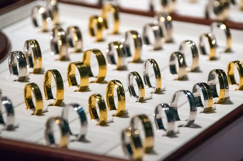 Pairs of engagement rings of various sizes sit on display