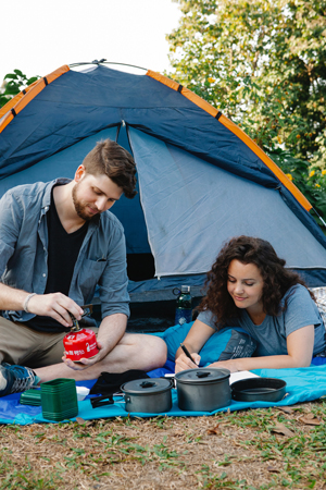 Young active couple camping